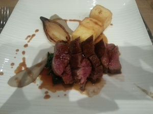 Scotch fillet steak with shitake puree, glazed onion, triple cooked chips, baby spinach and madeira jus